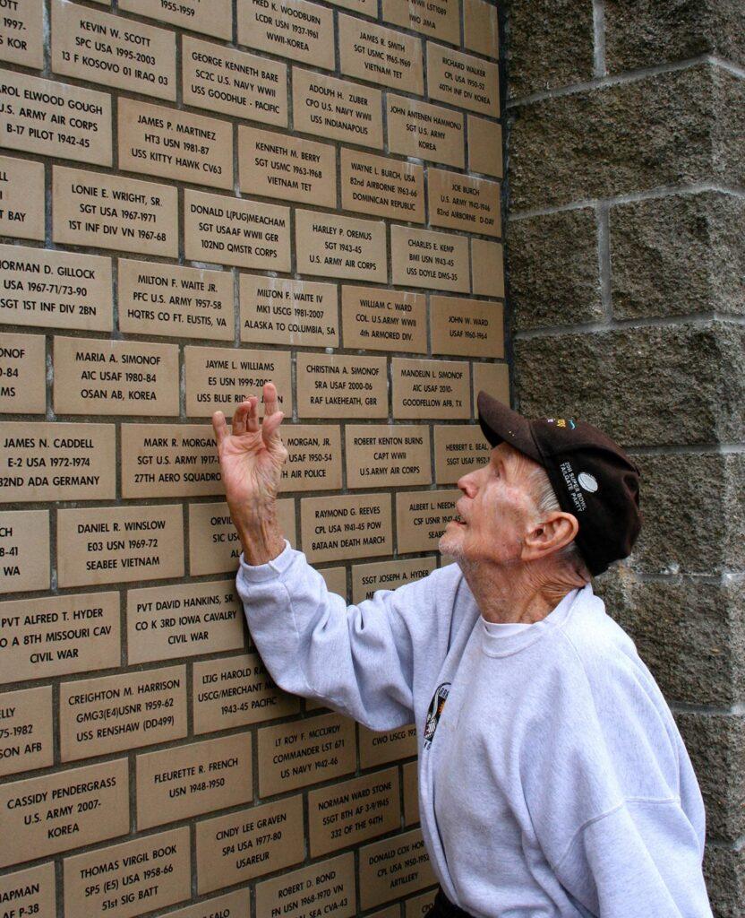 Veteran looking at memorial