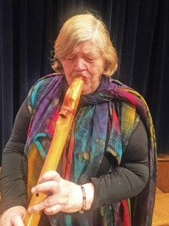 Diane Willis playing a flute