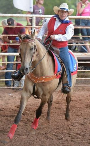 Linda Truax riding a horse